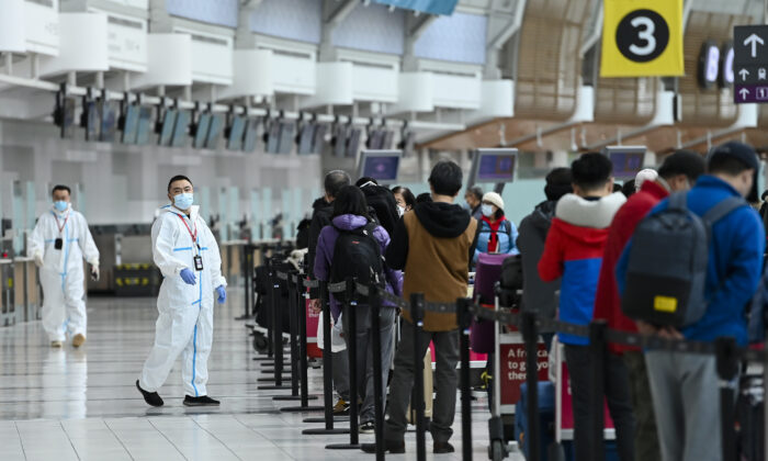 People line up and check in for an international flight at Pearson International airport during the COVID-19 pandemic in Toronto on Wednesday, Oct. 14, 2020. (THE CANADIAN PRESS/Nathan Denette)
