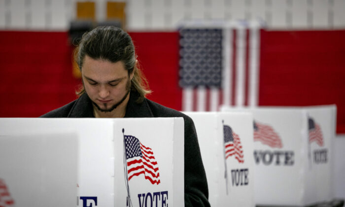 A voter fills in his ballot, in Lansing, Michigan, on Nov. 3, 2020. (John Moore/Getty Images)