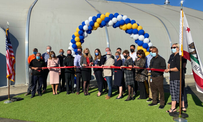Officials gather for a ribbon-cutting ceremony in front of a new homeless shelter in Huntington Beach, Calif., on Nov. 2, 2020. (Drew Van Voorhis/The Epoch Times)