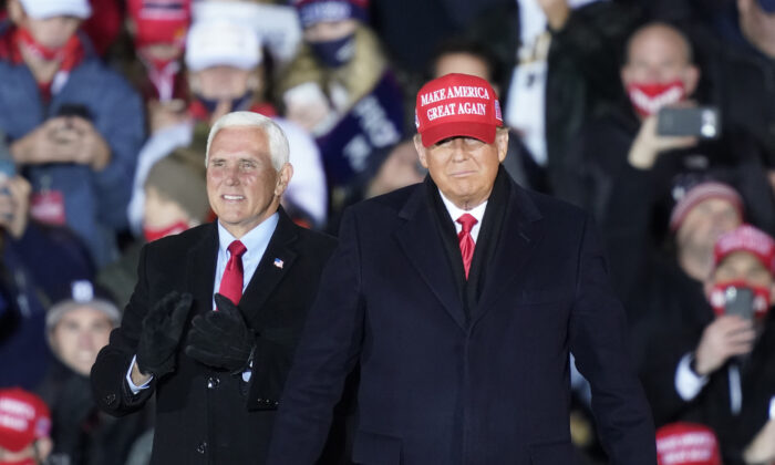 President Donald Trump arrives with Vice President Mike Pence for a campaign rally in Grand Rapids, Mich., Nov. 2, 2020. (Carlos Osorio/AP Photo)