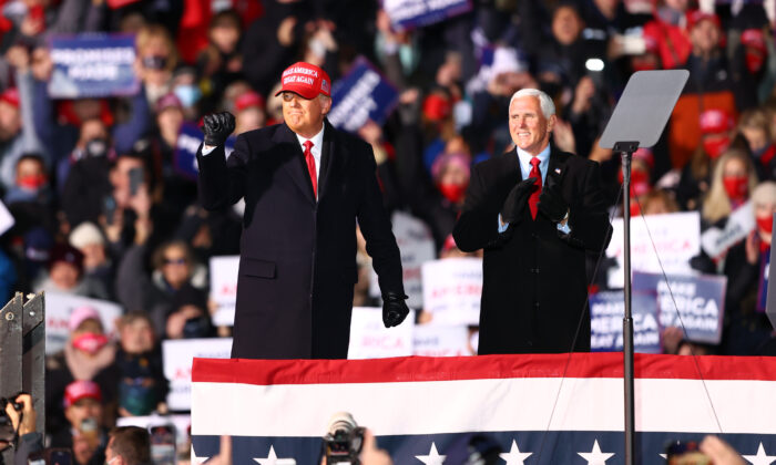 U.S. President Donald Trump (L) and U.S. Vice President Mike Pence (R) greet supporters at a rally in Traverse City, Mich., on Nov. 2, 2020. (Rey Del Rio/Getty Images)