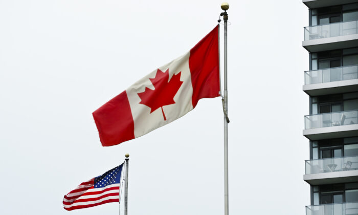 American and Canadian flags fly outside the United States consulate in Toronto on Nov. 3, 2020. (Nathan Denette/The Canadian Presss)