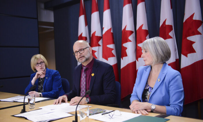 (L-R) Carla Qualtrough, Minister of Employment, Workforce Development and Disability Inclusion; David Lametti, Minister of Justice and Attorney General of Canada; and Patty Hajdu, Minister of Health, during a press conference at the National Press Theatre in Ottawa on Feb. 24, 2020 regarding the federal government's request to extend the deadline for revising its law on medical aid in dying. (The Canadian Press/Sean Kilpatrick)