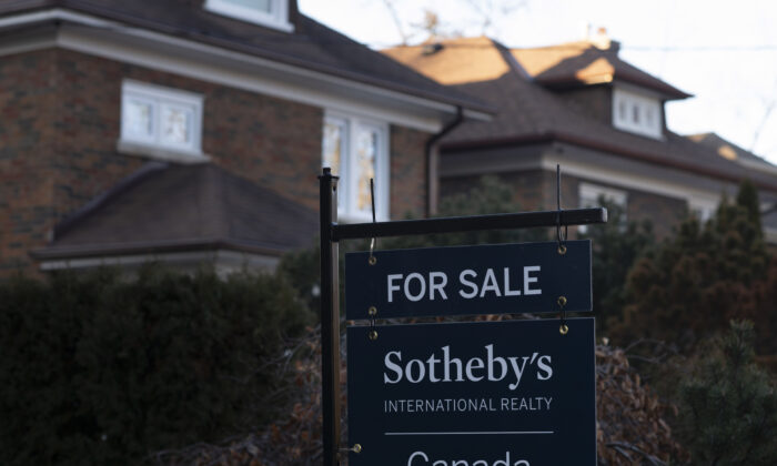 A real estate sale sign is shown in a west-end Toronto neighbourhood on March 7, 2020. (Graeme Roy/The Canadian Press)