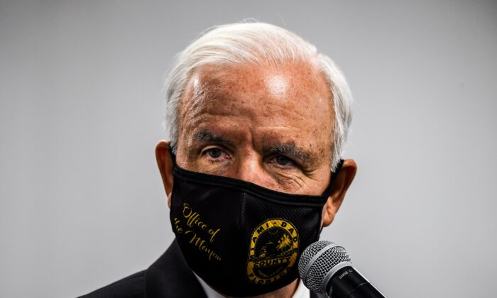 Miami-Dade County Mayor Carlos Gimenez wears a mask during a press conference to address the rise of CCP virus cases in the state, at Jackson Memorial Hospital in Miami on July 13, 2020. (Chandan Khanna/AFP via Getty Images)
