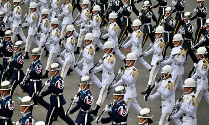 Taiwan's honor guards perform during the National Day celebration in front of the Presidential Office in Taipei on Oct. 10, 2020. (Sam Yeh/AFP via Getty Images)