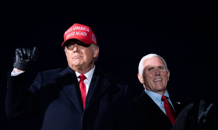 President Donald Trump arrives with Vice President Mike Pence for a Make America Great Again rally at Cherry Capital Airport in Traverse City, Michigan on Nov. 2, 2020. (Brendan Smialowski/AFP via Getty Images)