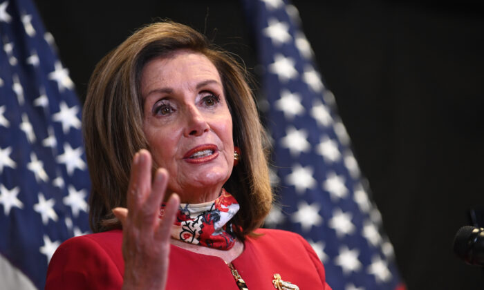 U.S. Speaker of the House Nancy Pelosi (D-Calif.) speaks to media at the Democratic National Committee headquarters on Capitol Hill in Washington on Nov. 3, 2020. (Erin Scott/Pool/Getty Images)
