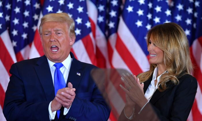 President Donald Trump claps alongside First Lady Melania Trump after speaking during election night in the East Room of the White House in Washington, early on Nov. 4, 2020. (Mandel Ngan/AFP via Getty Images)