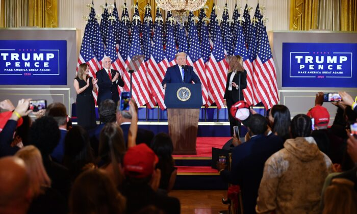 President Donald Trump, flanked by Karen Pence (L), Vice President Mike Pence, and First Lady Melania Trump, speaks during election night in the East Room of the White House early on Nov. 4, 2020. (Mandel Ngan/AFP via Getty Images)