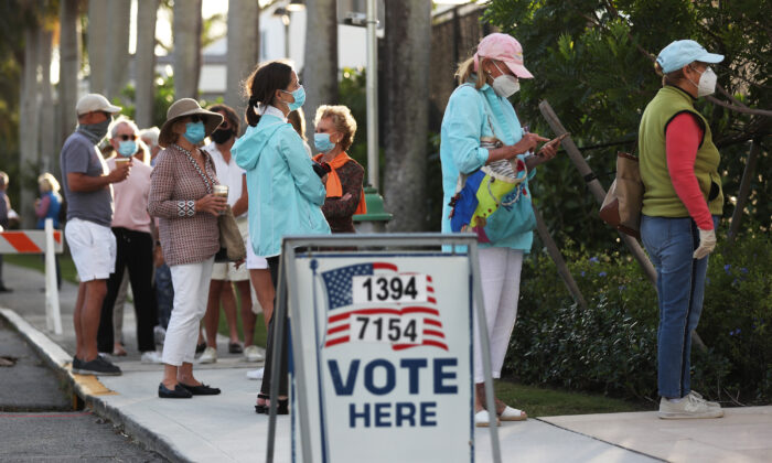 People stand in line to vote at the Morton and Barbara Mandel Recreation Center in Palm Beach, Fla., on Nov. 3, 2020. (Joe Raedle/Getty Images)