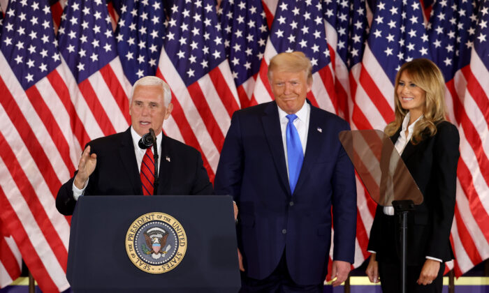 Vice President Mike Pence speaks as President Donald Trump and First Lady Melania Trump watch on election night in the East Room of the White House shortly after 2 am in Washington, DC. on Nov. 4, 2020. (Chip Somodevilla/Getty Images)