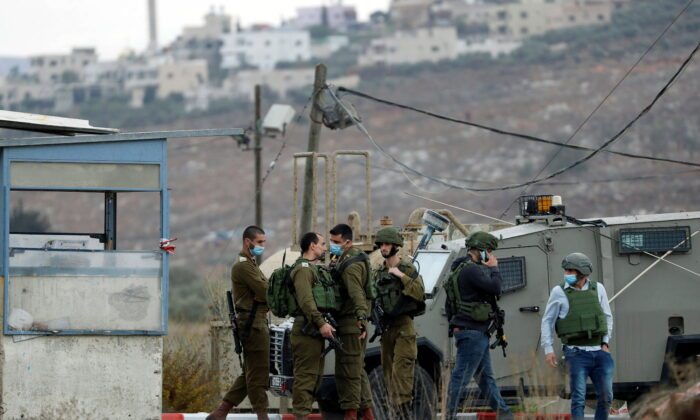 Members of Israeli forces gather at the scene of an incident at the Hawara checkpoint near the Palestinian city of Nablus, in the Israeli-occupied West Bank, on Nov. 4, 2020. (Mohamad Torokman/Reuters)