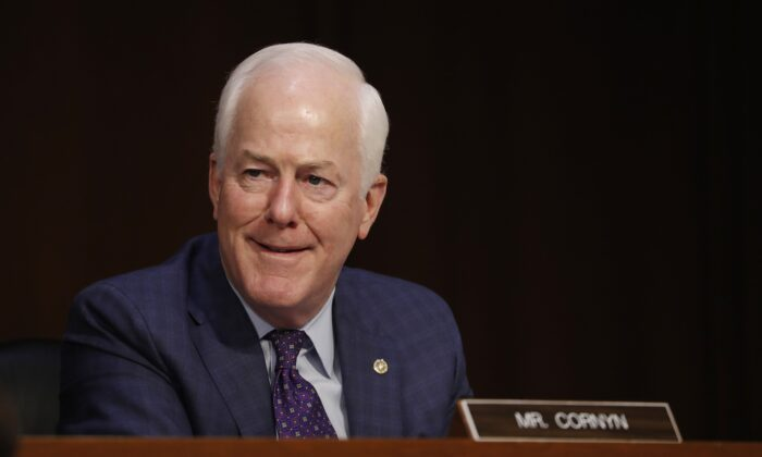 Sen. John Cornyn (R-Texas) reacts as Supreme Court nominee Judge Amy Coney Barrett participates in her confirmation hearing before the Senate Judiciary Committee on Capitol Hill in Washington, Oct. 12, 2020. (Shawn Thew/Pool/AFP via Getty Images)