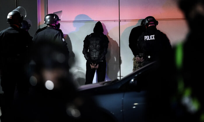 A man is detained by police on in Los Angeles, on Nov. 3, 2020. (Jae C. Hong/AP Photo)