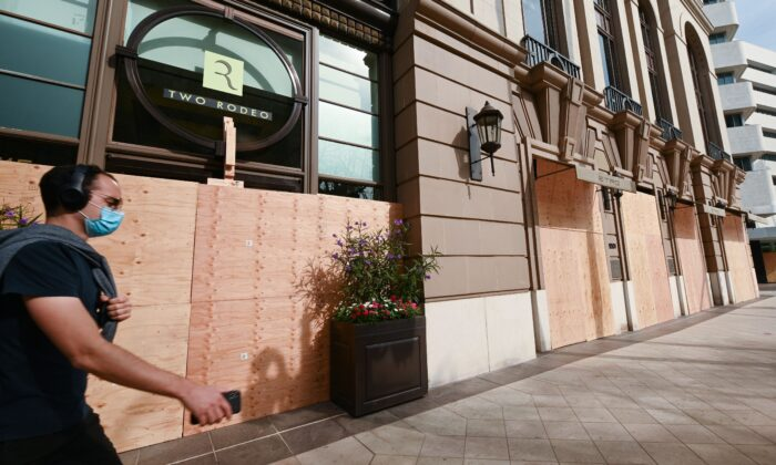Rodeo Drive, the world renowned shopping street in Beverly Hills, California, is boarded up and closed to vehicular and pedestrian traffic on Nov. 3, 2020 as a precaution against possible violence on the day of the US presidential election. (ROBYN BECK/AFP via Getty Images)