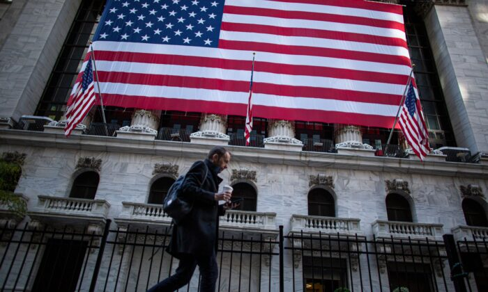A man walks by the New York Stock Exchange (NYSE) in New York, on Nov. 4, 2020. (KENA BETANCUR/AFP via Getty Images)