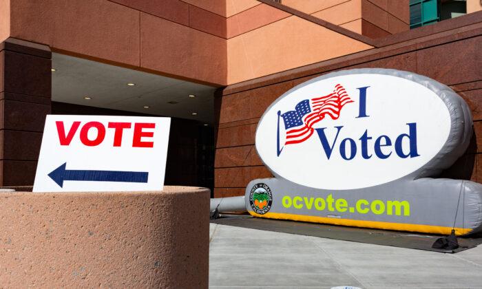 Voting signs at The Honda Center in Anaheim, Calif., on Nov. 2, 2020. (John Fredricks/The Epoch Times)