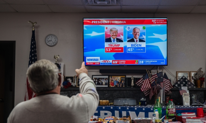 A man gestures as he watches the numbers coming in from Virginia in favor of President Trump at the Cochise County Republican Headquarters in Sierra Vista, Arizona on Nov. 3, 2020. (Ariana Drehsler/AFP via Getty Images)