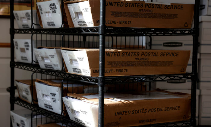 Boxes with mail-in ballots wait to be counted at the Northampton County Courthouse on Election Day in Easton, Penn., on Nov., 3, 2020. (Rachel Wisniewski/Reuters)