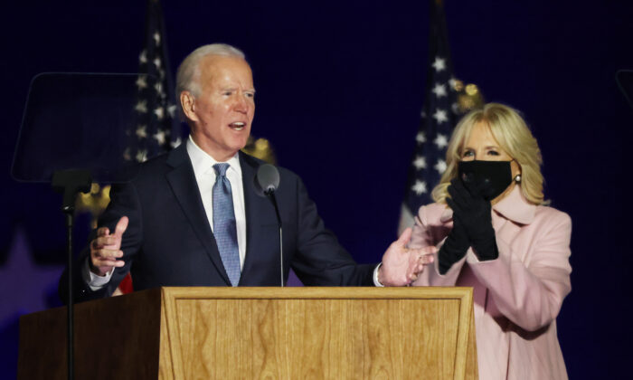 Democratic presidential nominee Joe Biden speaks at a drive-in election night event as Dr. Jill Biden looks on at the Chase Center in Wilmington, Delaware, in the early morning hours of Nov. 4, 2020. (Win McNamee/Getty Images)