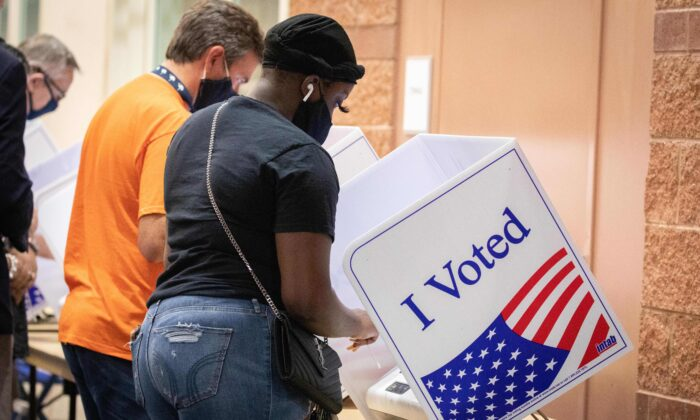 Voters cast their ballots in the voting booths at the early vote location at the Charleston Coliseum and Convention Center in North Charleston, South Carolina, on Oct. 16, 2020. (Logan Cyrus/AFP via Getty Images)