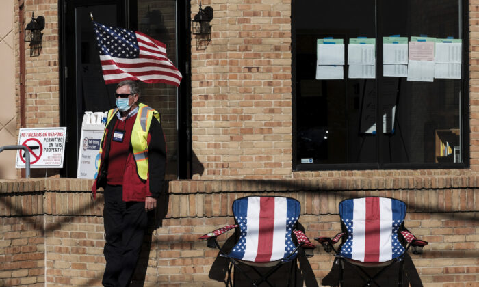 A poll worker sits outside and assists voters at a polling station at the Congregation Aguda Achim in Bexley in Columbus, Ohio, on Nov. 3, 2020. (Matthew Hatcher/Getty Images)