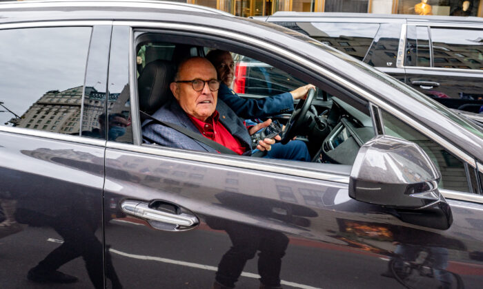 Former New York City Mayor and then-President Donald Trump's personal attorney Rudy Giuliani drives by a march and rally for President Donald Trump in New York City, N.Y., on Oct. 25, 2020. (David Dee Delgado/Getty Images)