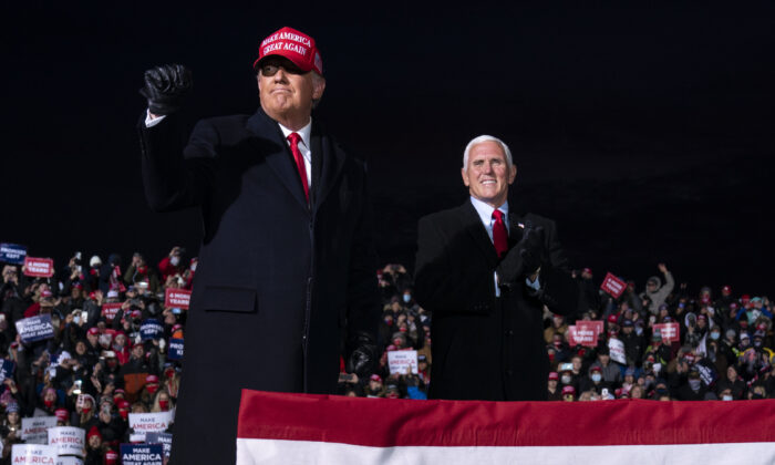 President Donald Trump and Vice President Mike Pence arrive for a campaign rally at Cherry Capital Airport in Traverse City, Mich., on Nov. 2, 2020. (Evan Vucci/AP Photo)