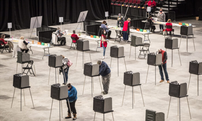 Voters fill out and cast their ballots at the Cross Insurance Center polling location where the entire city votes in Bangor, Maine, on Nov. 3, 2020. (Scott Eisen/Getty Images)