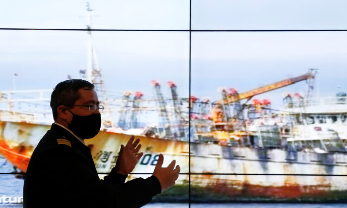 Chile's Commander Rodrigo Lepe, Chief of the fishing department of the maritime territory, shows a ship as a part of a large fleet of Chinese fishing vessels, who Chilean government is keeping tabs, while fishing along the Pacific Coast of South America, in Valparaiso, Chile Oct. 8, 2020. (REUTERS/Rodrigo Garrido)