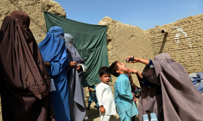 An Afghan health worker administers polio vaccine to a child in Arghandab district of Kandahar Province on Aug. 17, 2018. (Javed Tanveer/AFP via Getty Images)