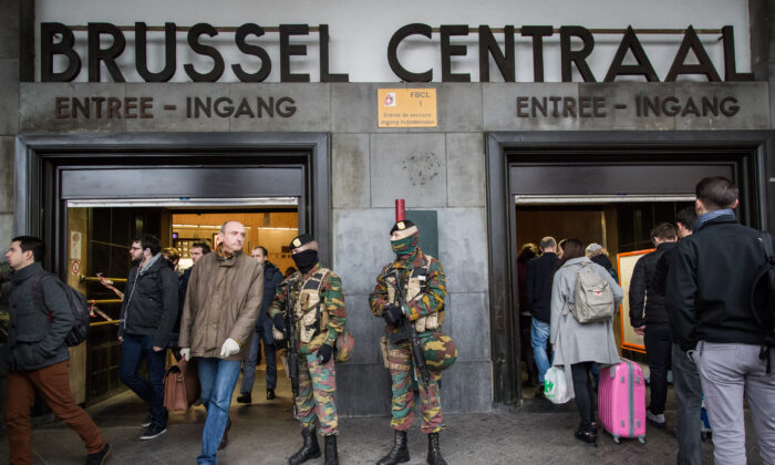 One day after the attacks on a Brussels airport and at a metro station, soldiers stand guard at the entrance of Brussels' central station on Mar. 23, 2016. (Aurore Belot/AFP via Getty Images)