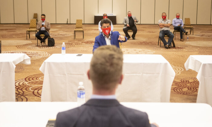 Jerry Dias, President of the Unifor union, sits opposite Matt Hough, General Motors' general director of human resources  and labour relations, at the start of formal contract talks with the Detroit Three automakers, Fiat Chrysler, Ford and General Motors, in Toronto, on Aug. 12, 2020. (The Canadian Press/Chris Young)