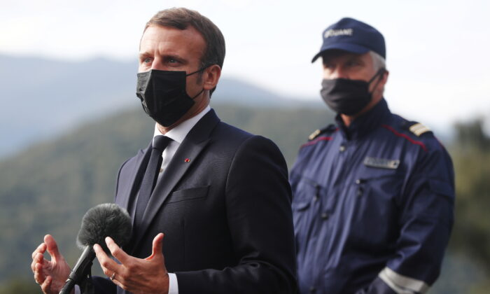 French President Emmanuel Macron speaks to media on strengthening the border controls at the crossing between Spain and France, at Le Perthus, France, on Nov. 5, 2020. (Guillaume Horcajuelo/Pool via Reuters)
