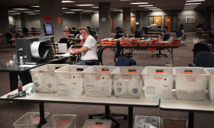 Election officials count absentee ballots in Milwaukee, Wis. on Nov. 4, 2020. (Scott Olson/Getty Images)