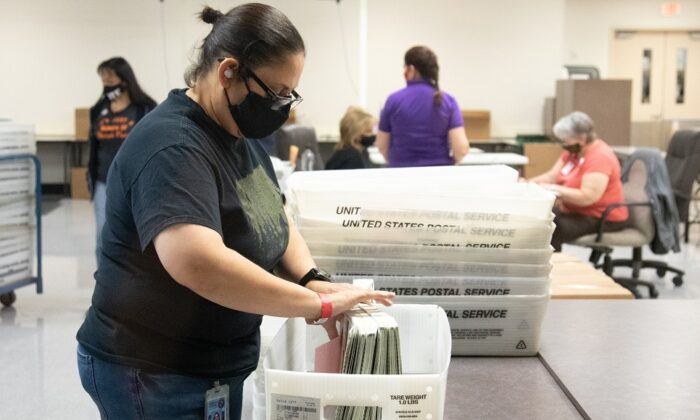 A Maricopa County Elections Department staff member counts ballots in Phoenix, on Oct. 31, 2020. Early voting lasted from Oct. 7 through Oct. 30 in Arizona, which had a record number of early voters. (Courtney Pedroza/Getty Images)