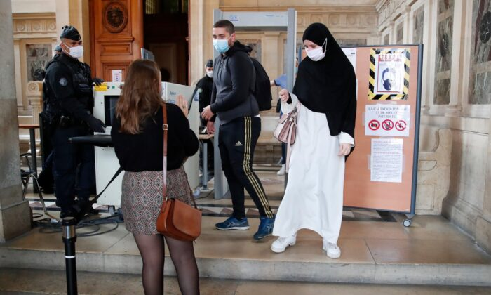 People are being checked before the trial of Sidi Ahmed Ghlam in Lyon, France, on Oct. 5, 2020. (Francois Mori/AP Photo)