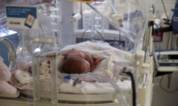 A new-born baby in the maternity ward at Frimley Park Hospital, in Frimley in Surrey, England, on May 22, 2020. (Steve Parsons - Pool/Getty Images)