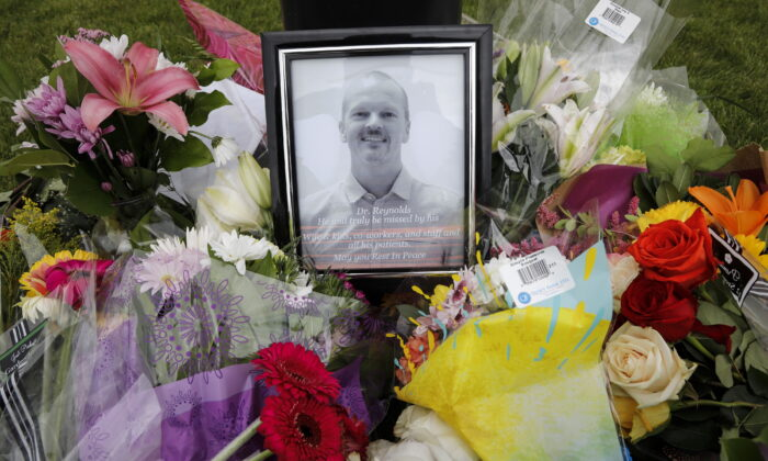 An impromptu memorial for Dr. Walter Reynolds, who died after he was attacked in an examination room rests outside the Village Mall walk-in clinic in Red Deer, Alta., on Aug. 11, 2020.  (The Canadian Press/Jeff McIntosh)