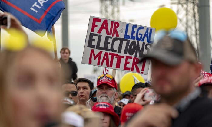 Supporters of President Donald Trump in front of  the Maricopa County Election Department while votes are being counted in Phoenix, Ariz., on Nov. 6, 2020. (Olivier Touron/AFP via Getty Images)