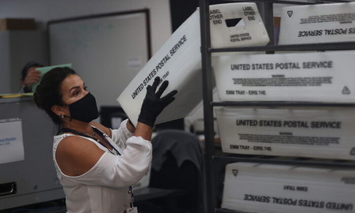 A worker at the Miami-Dade County Elections Department works on tabulating the Vote by Mail ballots that have been returned in Doral, Fla. on Nov. 3, 2020. (Joe Raedle/Getty Images)