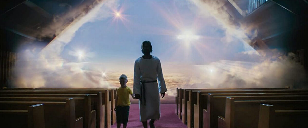 """small boy and Jesus in a movie theater in """"Heaven is for Real"""""""