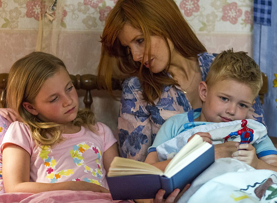"""mother, daughter, and son read a book in bed in """"Heaven is for Real"""""""