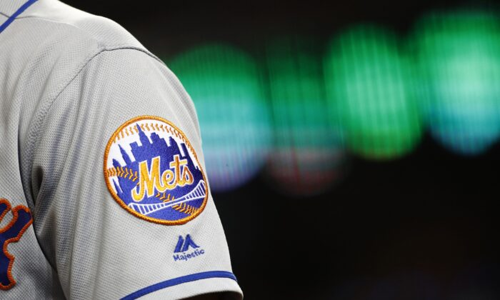 The New York Mets logo is seen on Brandon Nimmo's sleeve as he prepares for an at-bat during a baseball game against the Washington Nationals in Washington on Sept. 3, 2019. (Patrick Semansky/AP Photo, File)