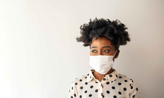 Masks have become a divisive issue as some seek safety and others lament the unintended consequences. (Dragana Gordic/Shutterstock)
