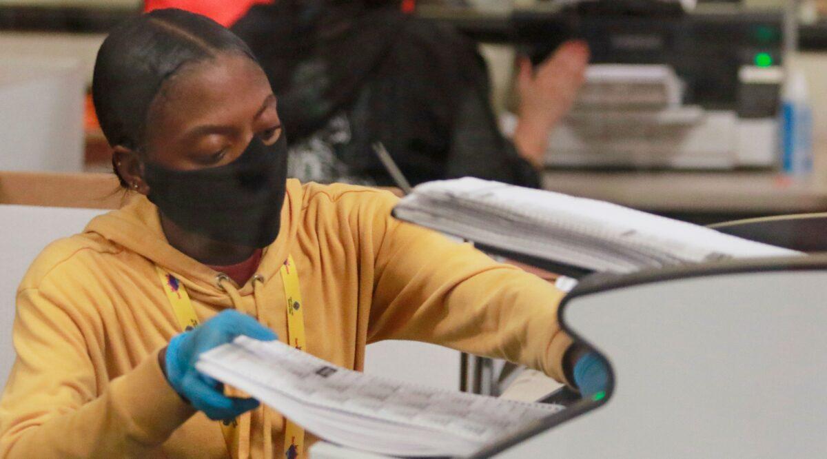 A worker handles official ballots