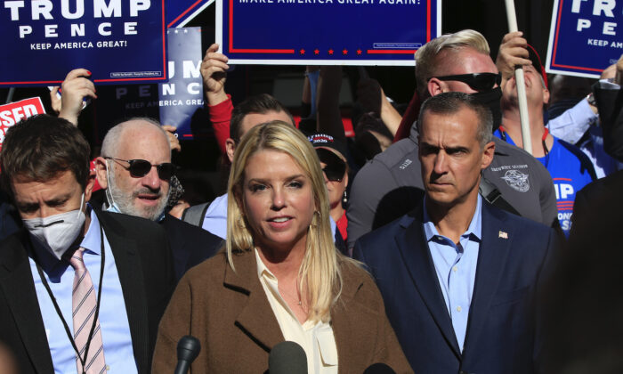 Former Florida Attorney General Pam Bondi, with Trump campaign adviser Corey Lewandowski (C R), speaks outside the Pennsylvania Convention Center in Philadelphia, Pennsylvania on Nov. 5, 2020. (Kena Betancur/AFP via Getty Images)