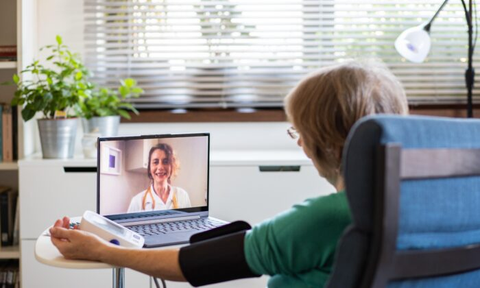 COVID-19 has forced many physicians and patients to adopt virtual appointments through telephone or video conferencing. The move has revealed the convenience of this approach. (Melinda Nagy/Shutterstock)