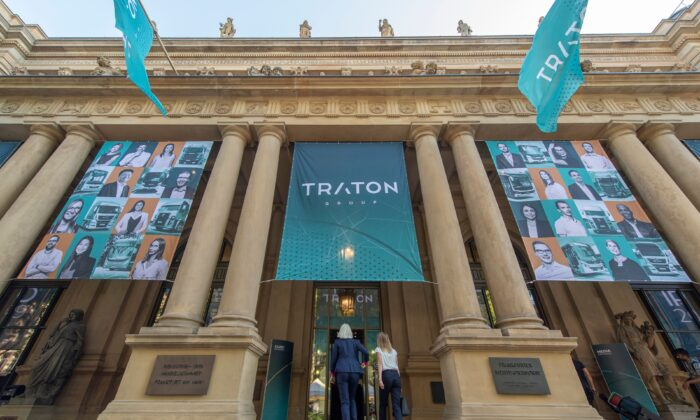 Traton SE posters are fixed at the entrance to the stock exchange in Frankfurt am Main, western Germany, on June 28, 2019. (Boris Roessler/DPA/AFP via Getty Images)